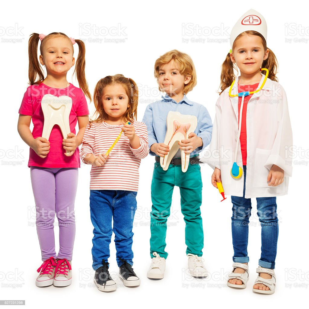 Four little children playing doctors stock photo