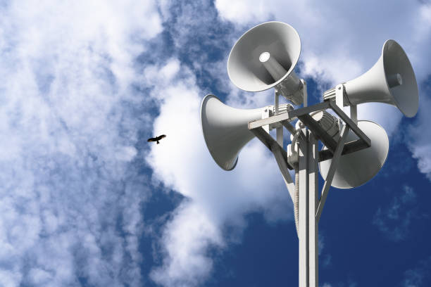 four loudspeakers are attached to a rack against a background of clouds and a bird. - emissione radio televisiva foto e immagini stock