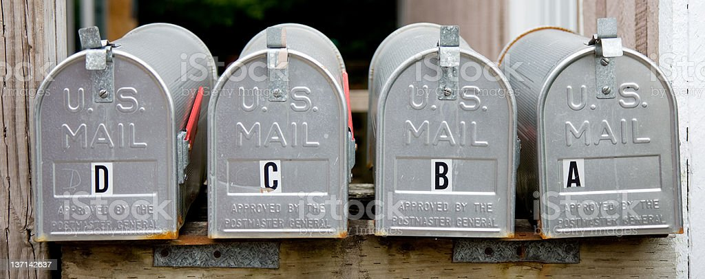 Four Mailboxes In a Row stock photo
