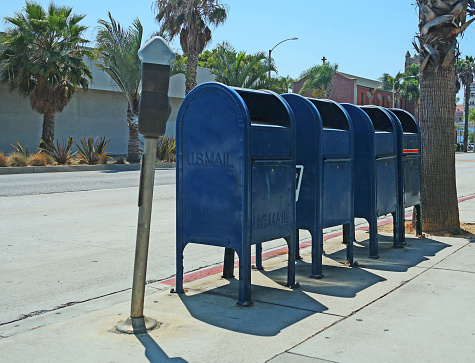 Four Mailboxes on the Sidewalk