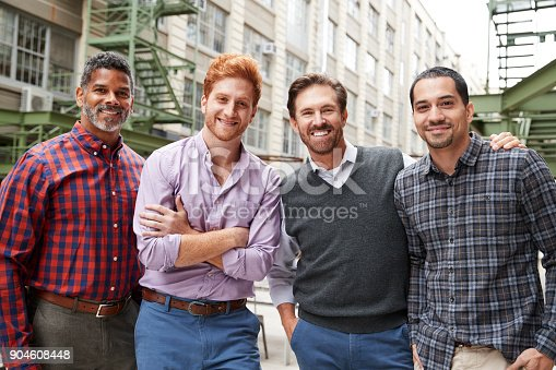 istock Four male coworkers smiling to camera outside 904608448