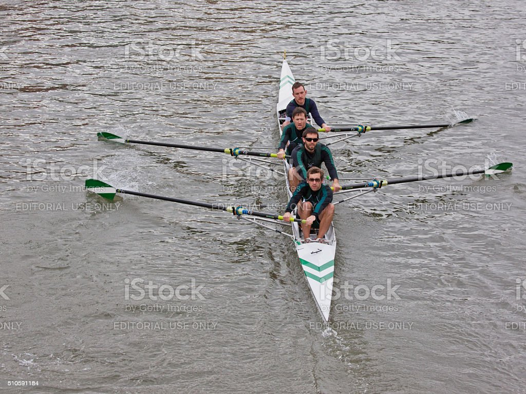 Four man crew pulling in harmony in a river race stock photo