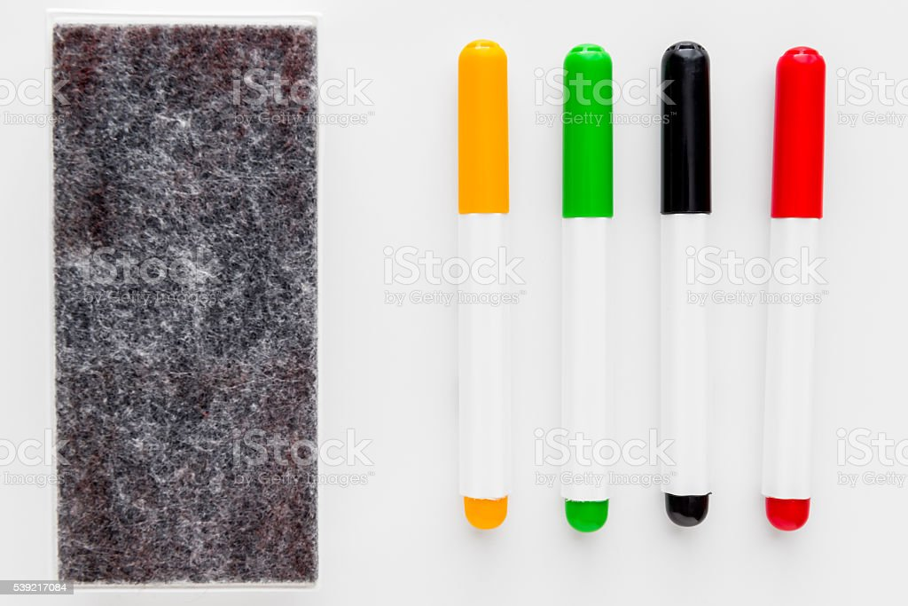four markers and felt for office white whiteboard isolated stock photo