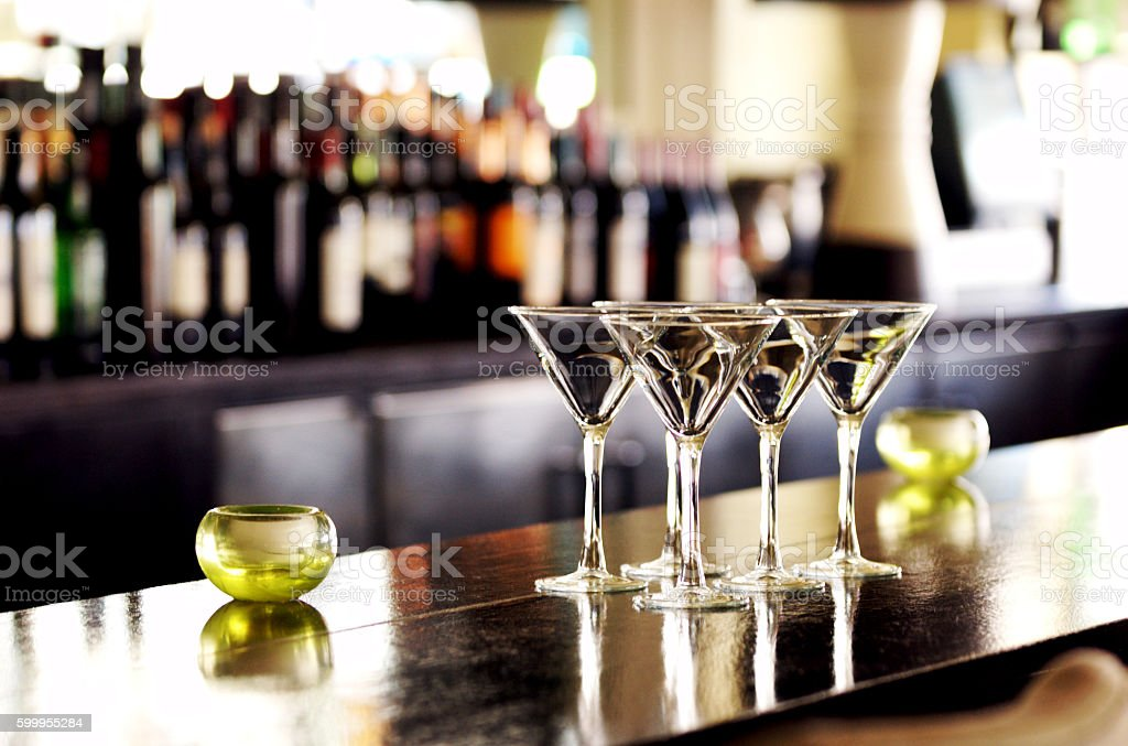 Four Martini Glasses on Bar stock photo