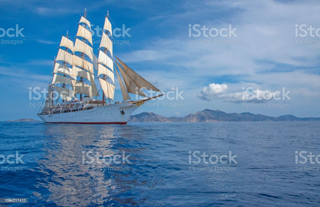 Four Mast Windjammer in the Cyclades stock photo