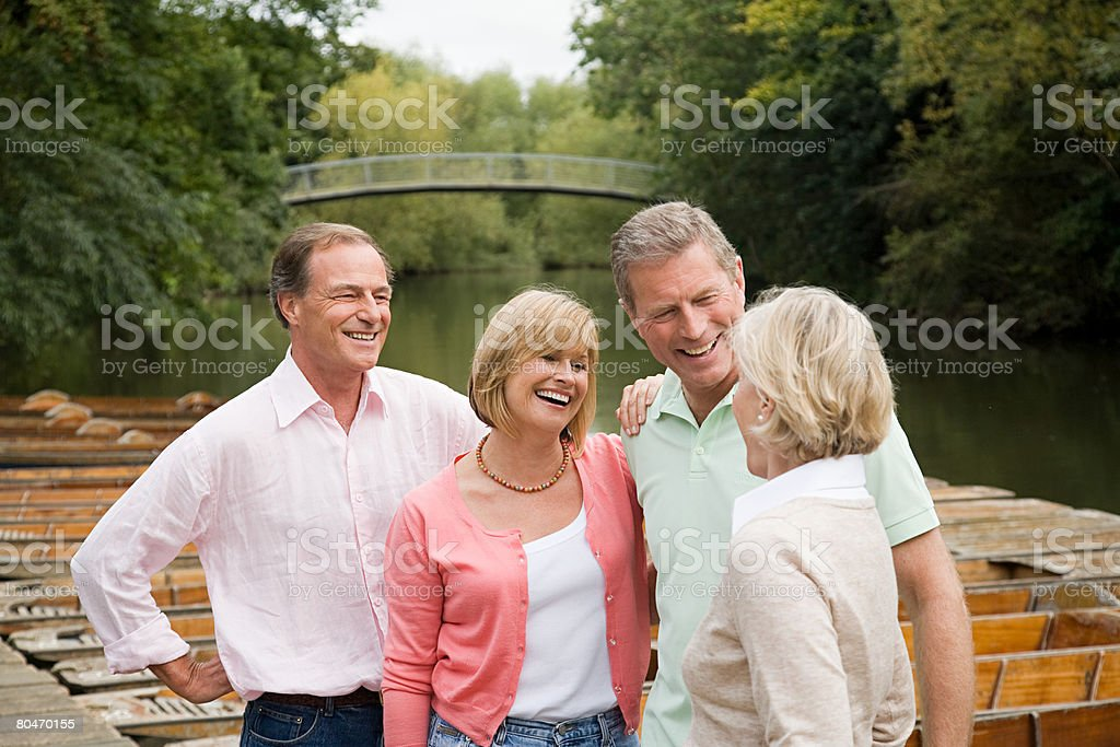 Four mature friends by river royalty-free stock photo