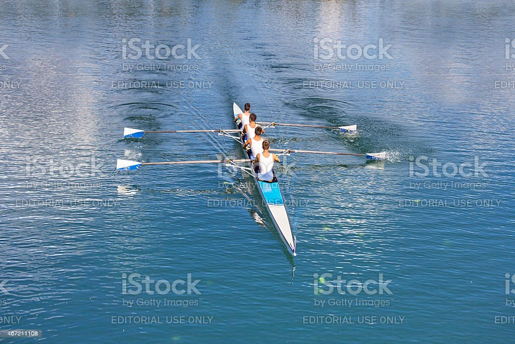 Four men rowing stock photo