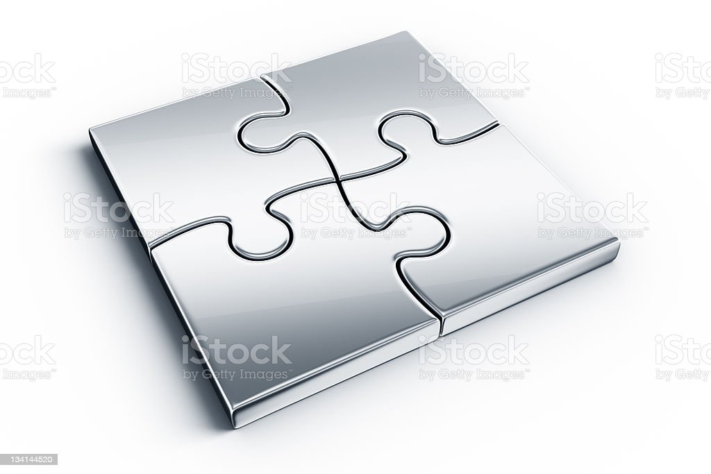 Four metal joined puzzle pieces over a white background stock photo