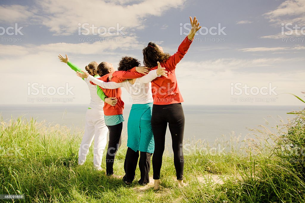 Four Middle age women open arms outdoors royalty-free stock photo