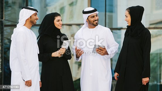 istock Four middle eastern business people chatting 471250190