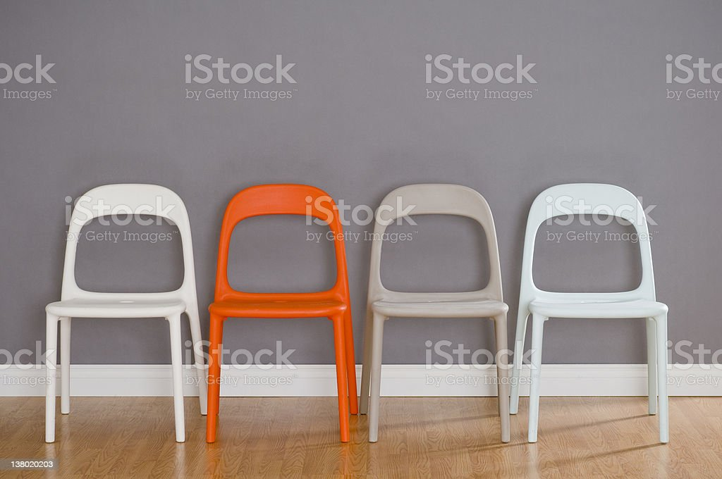 Four Modern Plastic Chairs stock photo