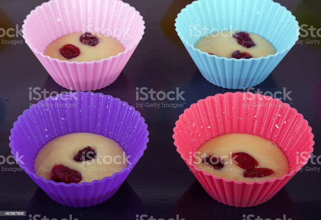 Four muffin's form with dough stock photo