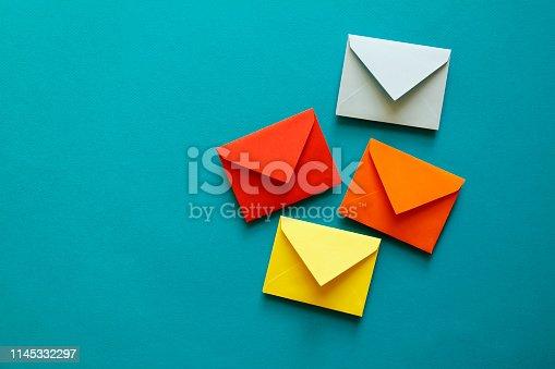 Four multi-coloured envelopes
