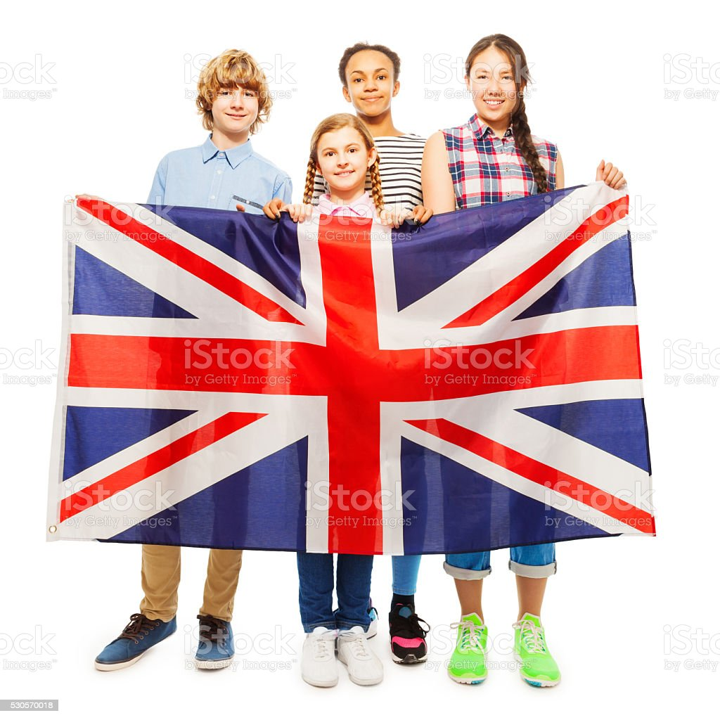 Four multiethnic teenage kids holding British flag stock photo