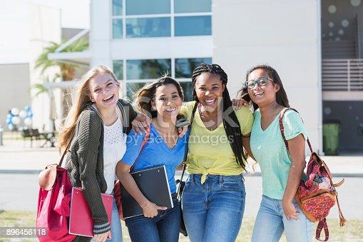 istock Four multi-ethnic teenage students on campus 896456118