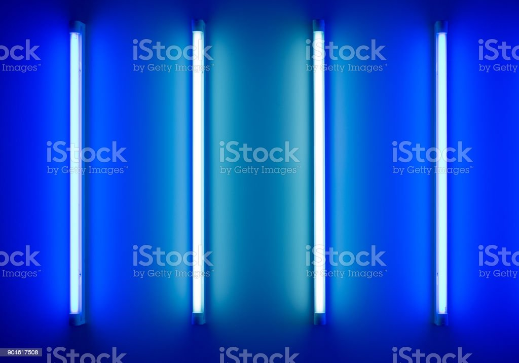 four neon tubes or lamps on the wall stock photo