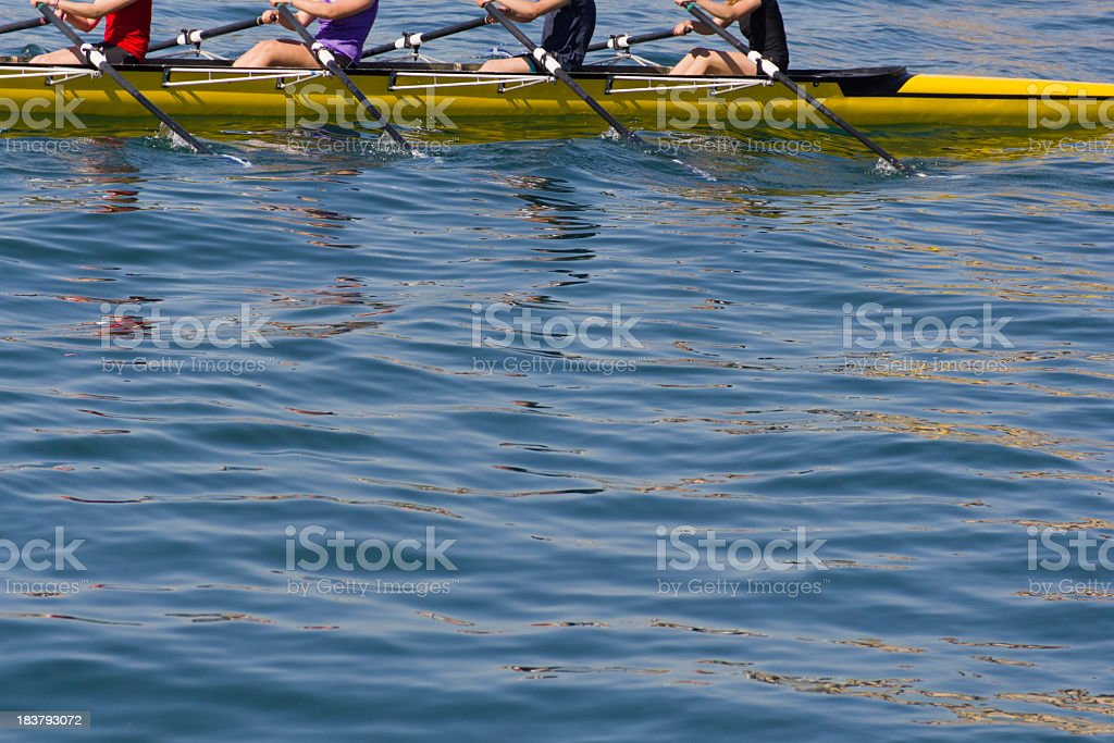 Four oarsmen rowing together in a sculling boat stock photo