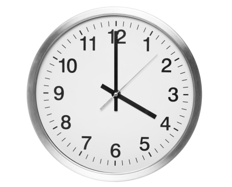 Round office clock showing two o'clock isolated on white background