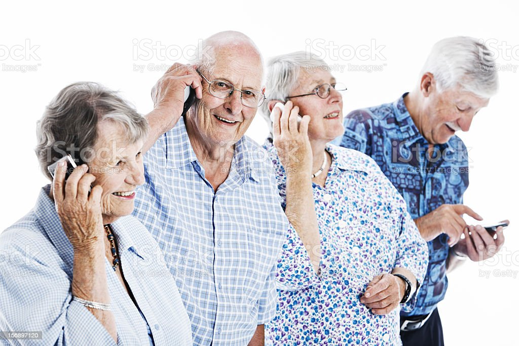 Four old people confidently using cell phones and smiling royalty-free stock photo