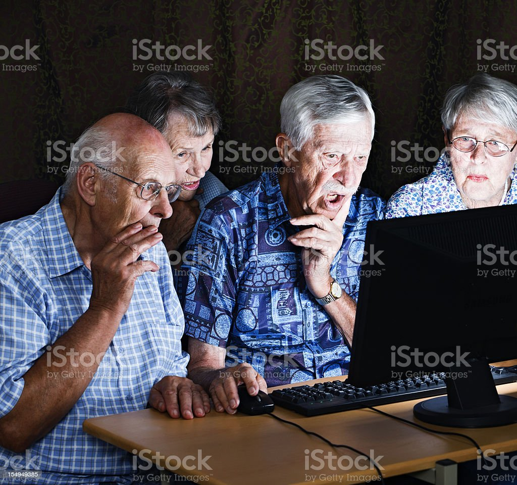 Four old people shocked by image on computer monitor royalty-free stock photo