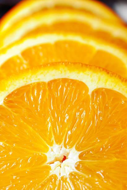 Four Orange slices stock photo