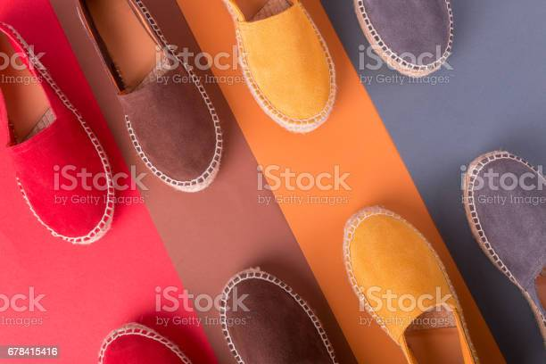 Four pair of espadrilles on multicolor background top view picture id678415416?b=1&k=6&m=678415416&s=612x612&h=23js8rn6s hsqorwvo7uavrkpoty2xqwmndrzh9m8oo=