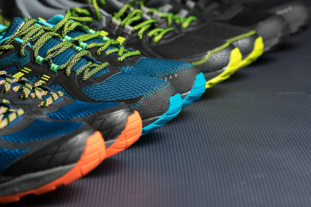 Four pairs of running shoes stock photo