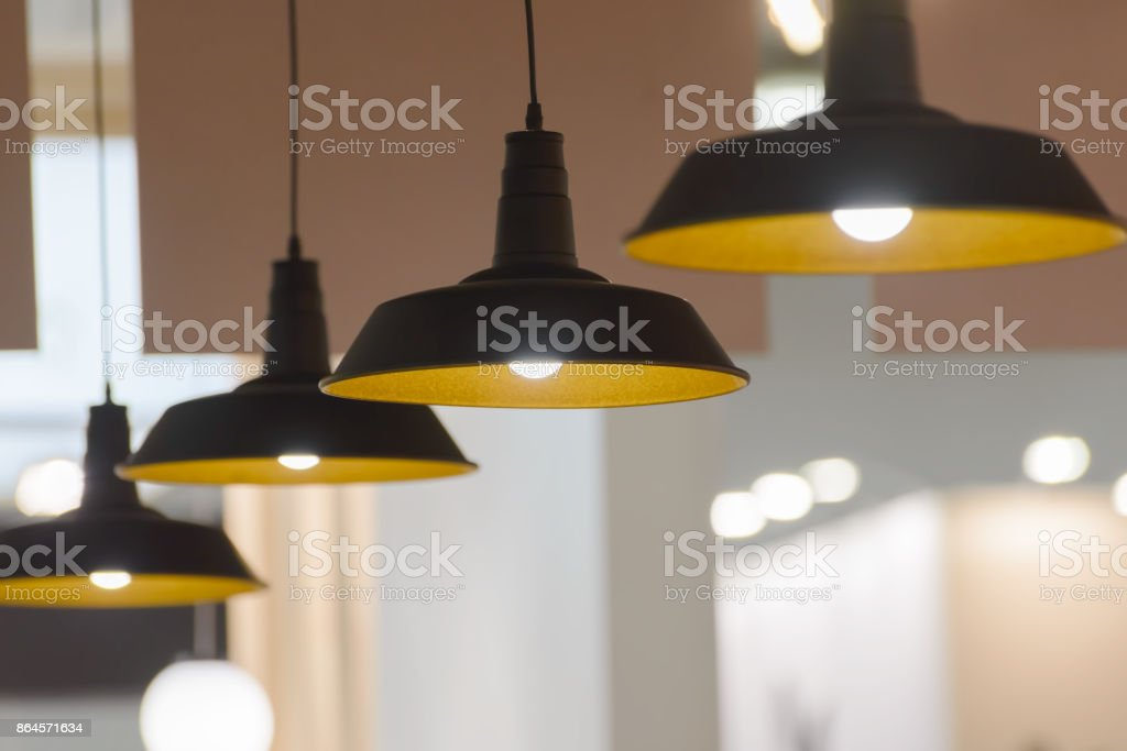 four pendant lamps blurred background stock photo