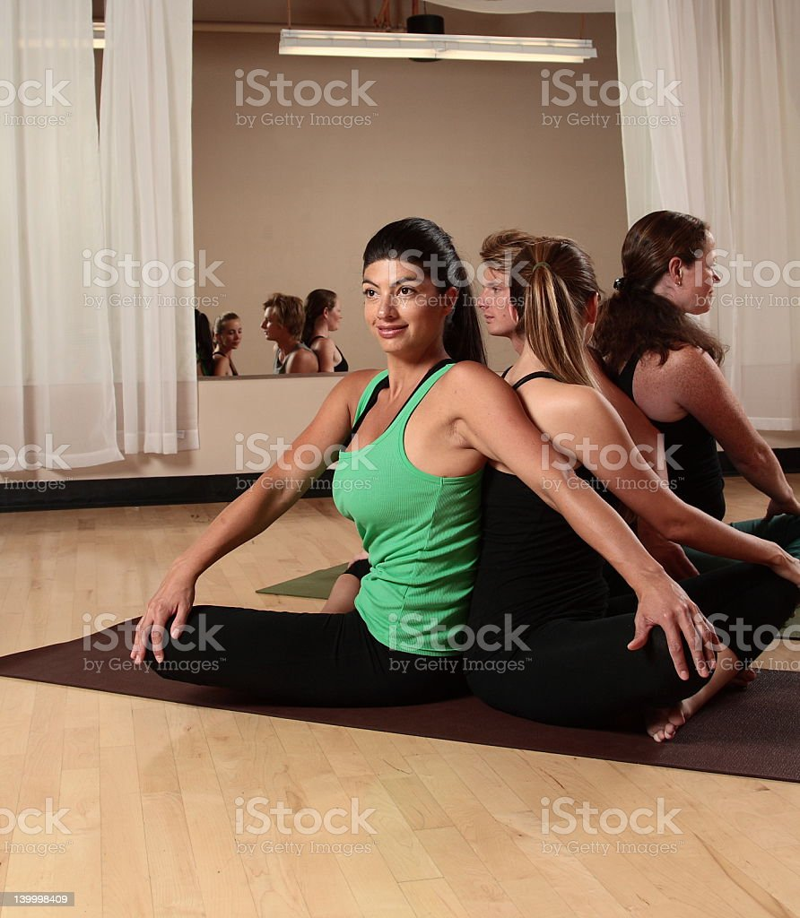 Four People Doing Yoga Pose Stock Photo - Download Image Now