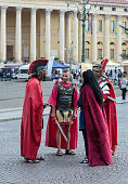 Verona, Italy, September 27, 2015 : Four people dressed in the form of Roman legionaries stand at the Piazza Bra square near the Arena in Verona, Italy