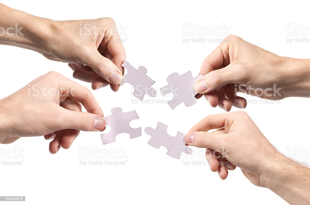 Four People Holding Puzzle royalty-free stock photo