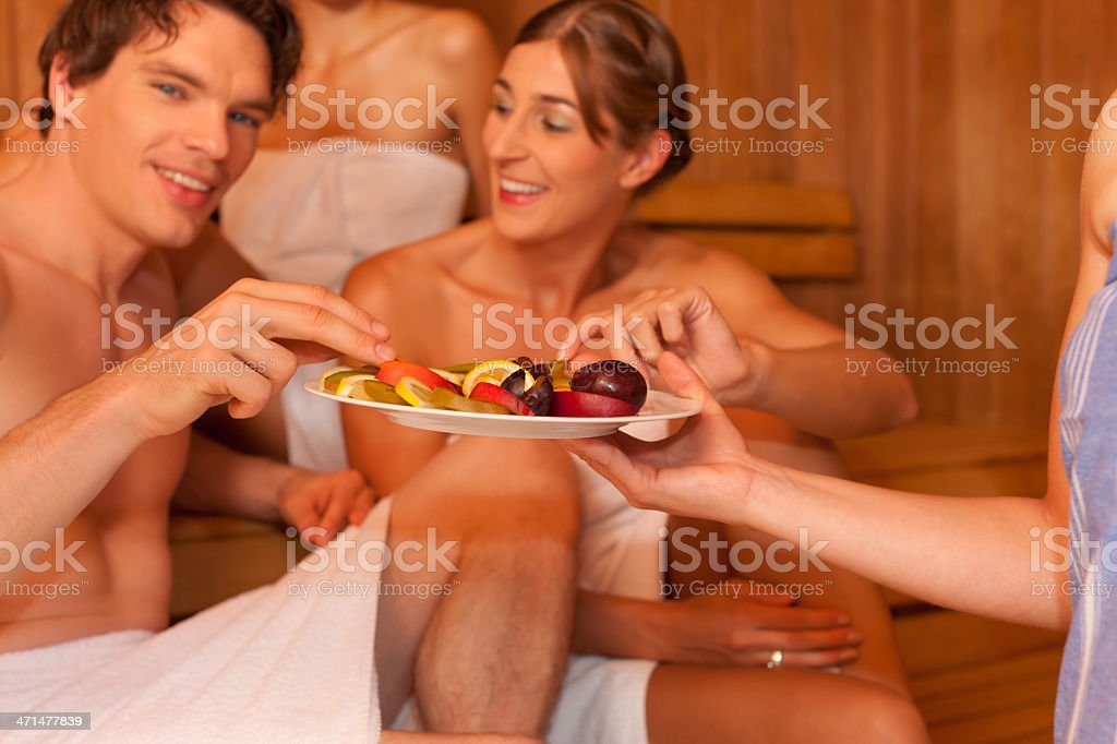 Four people or friends in sauna royalty-free stock photo
