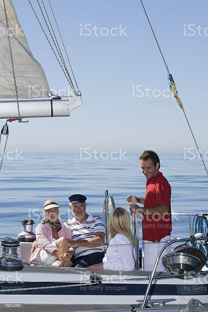 Four people sailing royalty-free stock photo