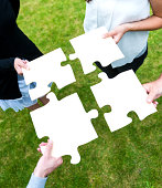 istock Four people teamwork and connect jigsaw puzzle 187105958