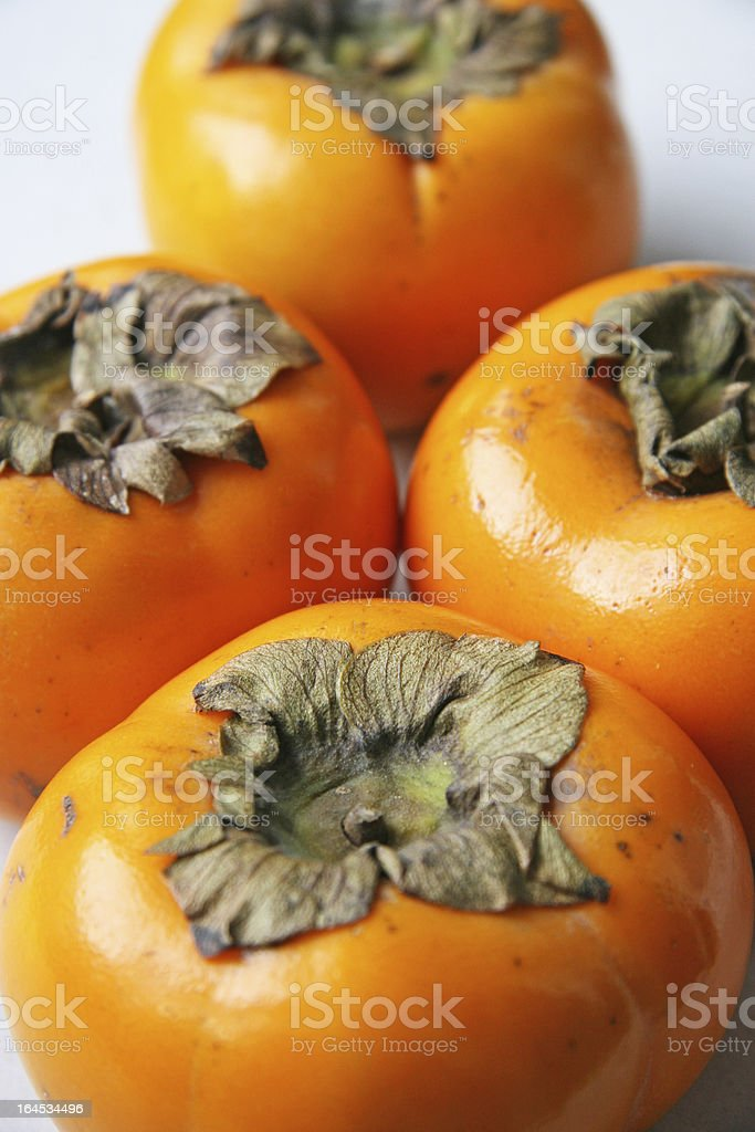 four persimmon royalty-free stock photo