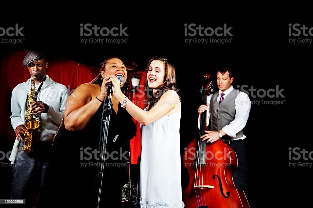 Four piece band playing stock photo