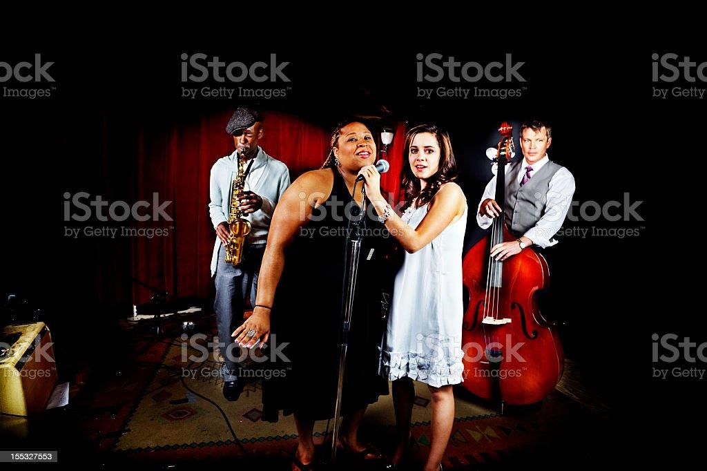 Four piece nightclub band stock photo