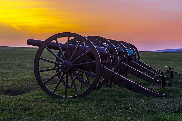 Four pieces of artillery  at Antietam National Battlefield Four pieces of artillery in a row at Antietam National Battlefield in Sharpsburg, Maryland. The battle at Antietam was the bloodiest single-day battle in American history. robert e. lee stock pictures, royalty-free photos & images
