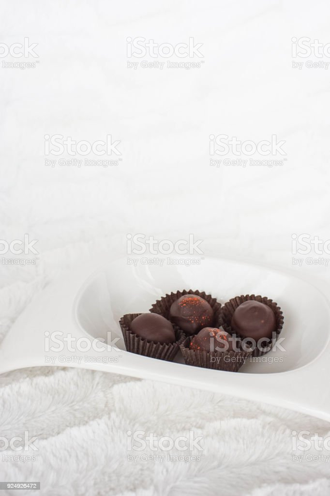 four pieces of chocolate in a bowl stock photo