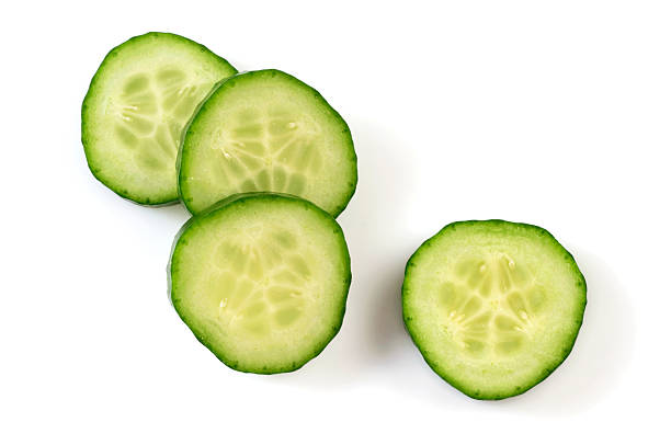 Four pieces of Cucumber slices stock photo