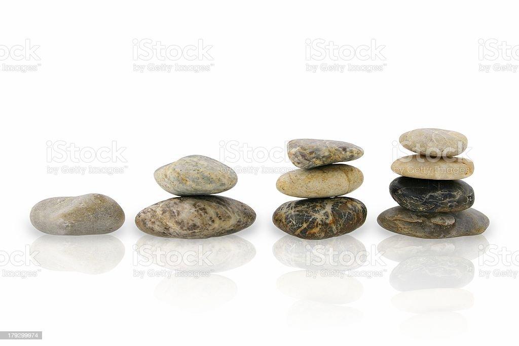 Four piles of pebbles stock photo