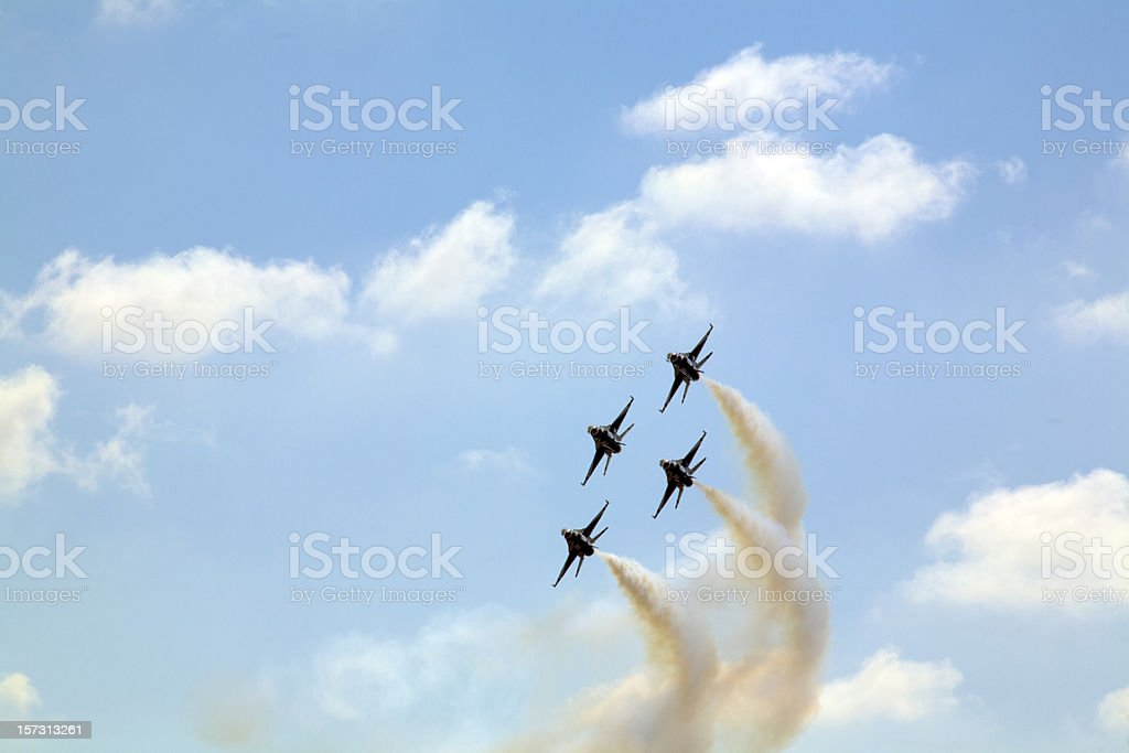 Four planes in formation in the sky stock photo