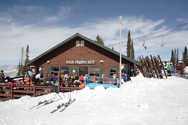 Four Points Hut, Steamboat Springs ski resort Steamboat Springs, Colorado, USA.  February 15,2011.  Skiers and snowboarders relaxing and eating lunch on the outside sundeck at  Four Points Hut, a mid-mountain lunch spot at Steamboat Springs ski resort. routt county stock pictures, royalty-free photos & images