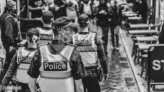 istock Four Police on patrol 1148403820