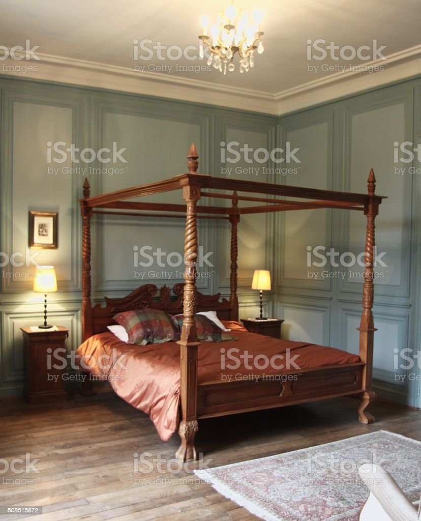 Four Poster Antique Bed And Bedroom stock photo