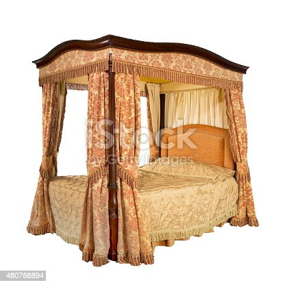 Old vintage four poster bed with drapes and curtains isolated on white with clipping path
