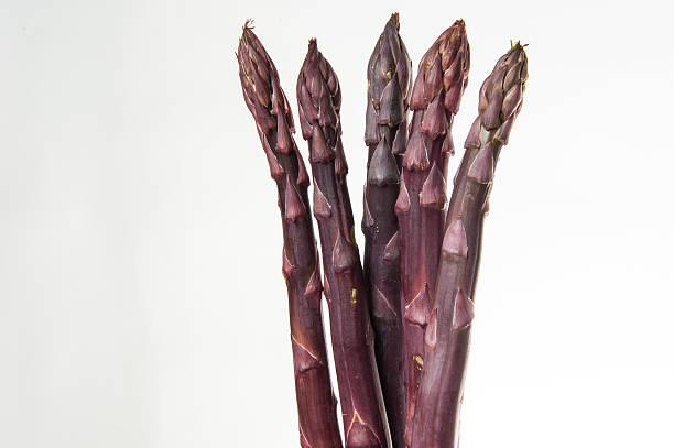 Four Purple Asparagus stock photo