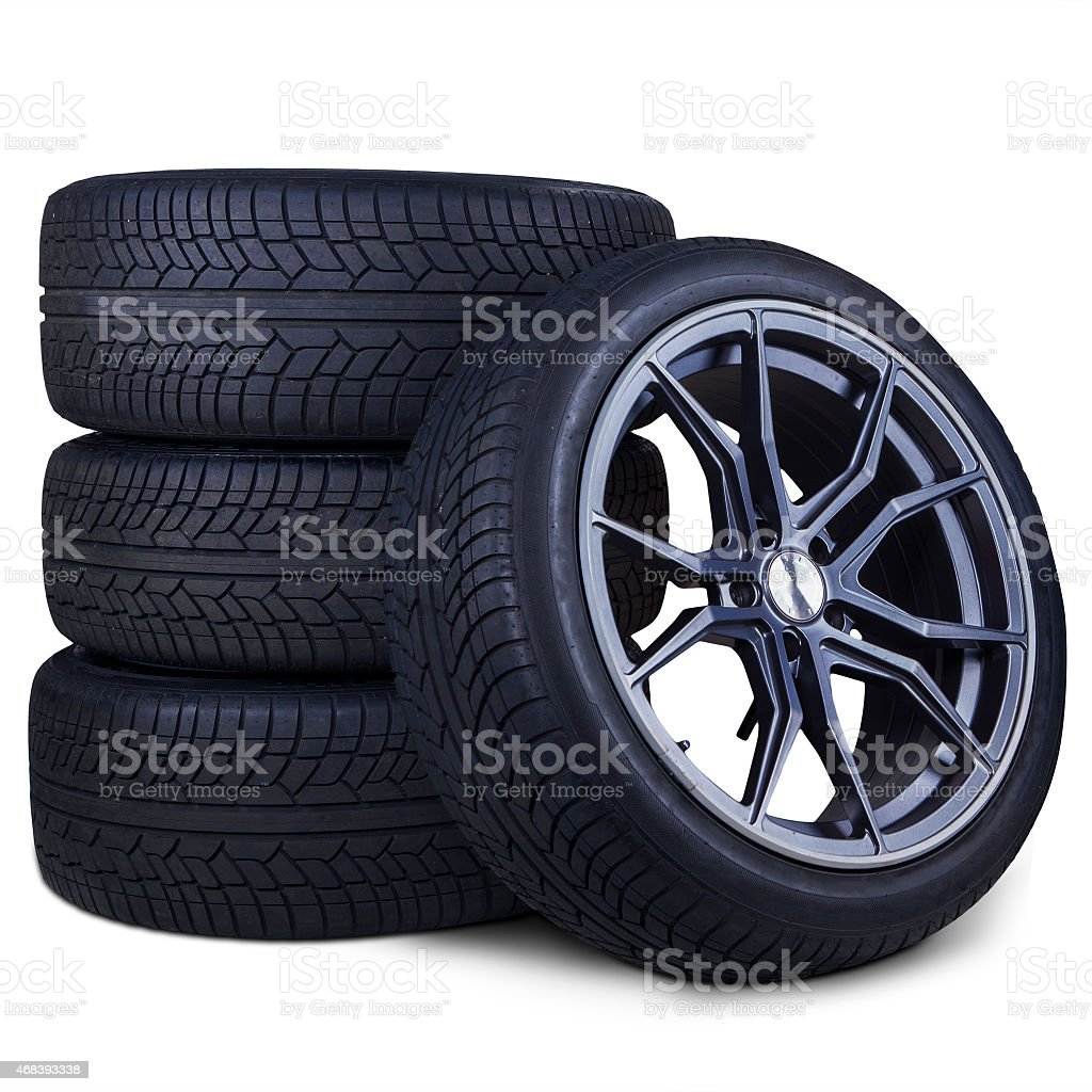 Four racing tires isolated stock photo
