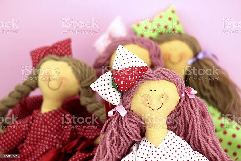 Four rag dolls stock photo
