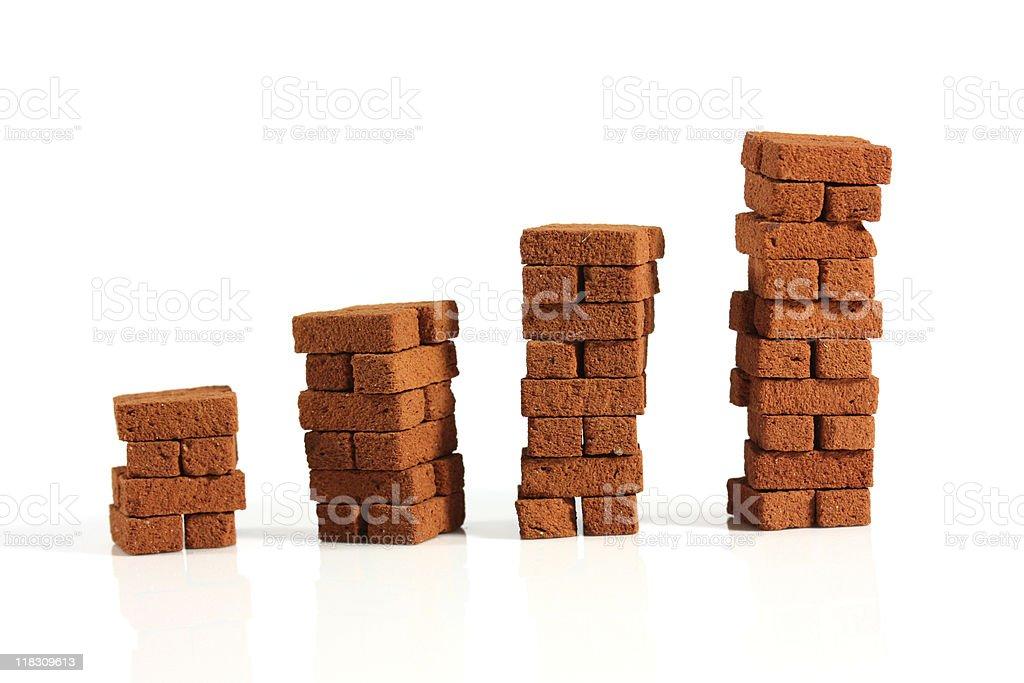 Four raising brick pillars stock photo